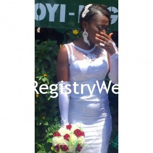 Bride shows off her ring , earring and hair accessory