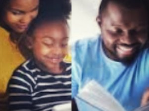 Father and mother reading with their daughter